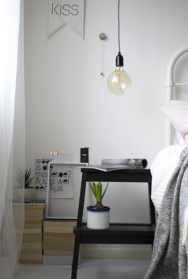 Bright, minimal bedroom, globe bulb light