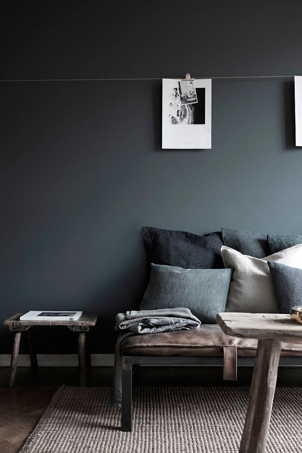 Black wall tunnel vision curate display Grey interior walls
