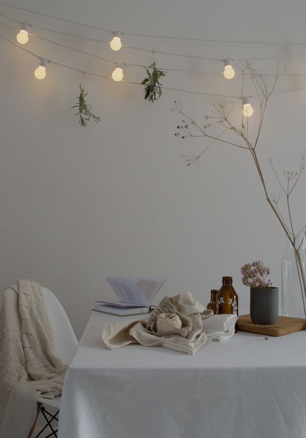Out_There_Interiors_DIY_Wooden_Bead_Chandelier_String_Lighting_Winter04