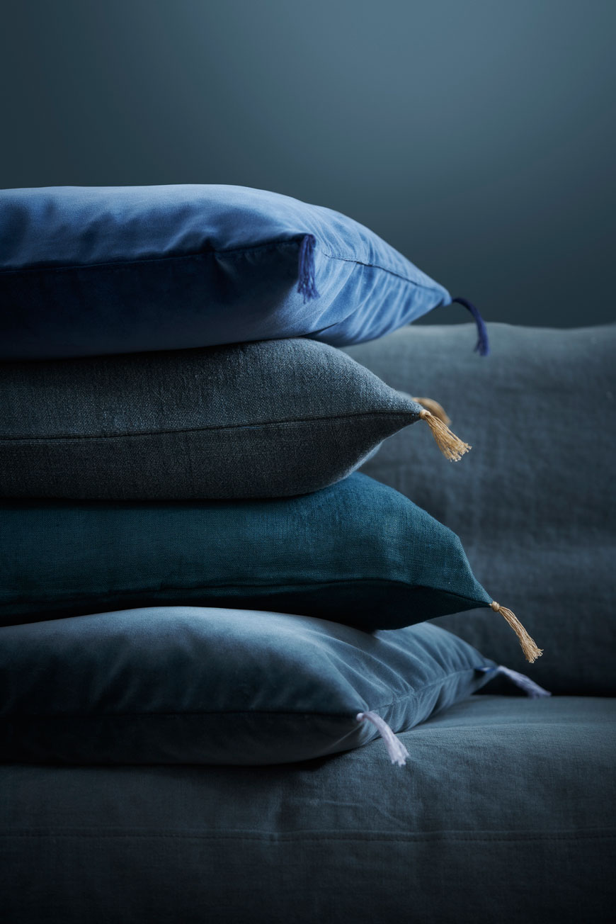 Organic, sustainable blue velvet and linen cushions, designed by sustainable Swedish furniture designers Norrgavel